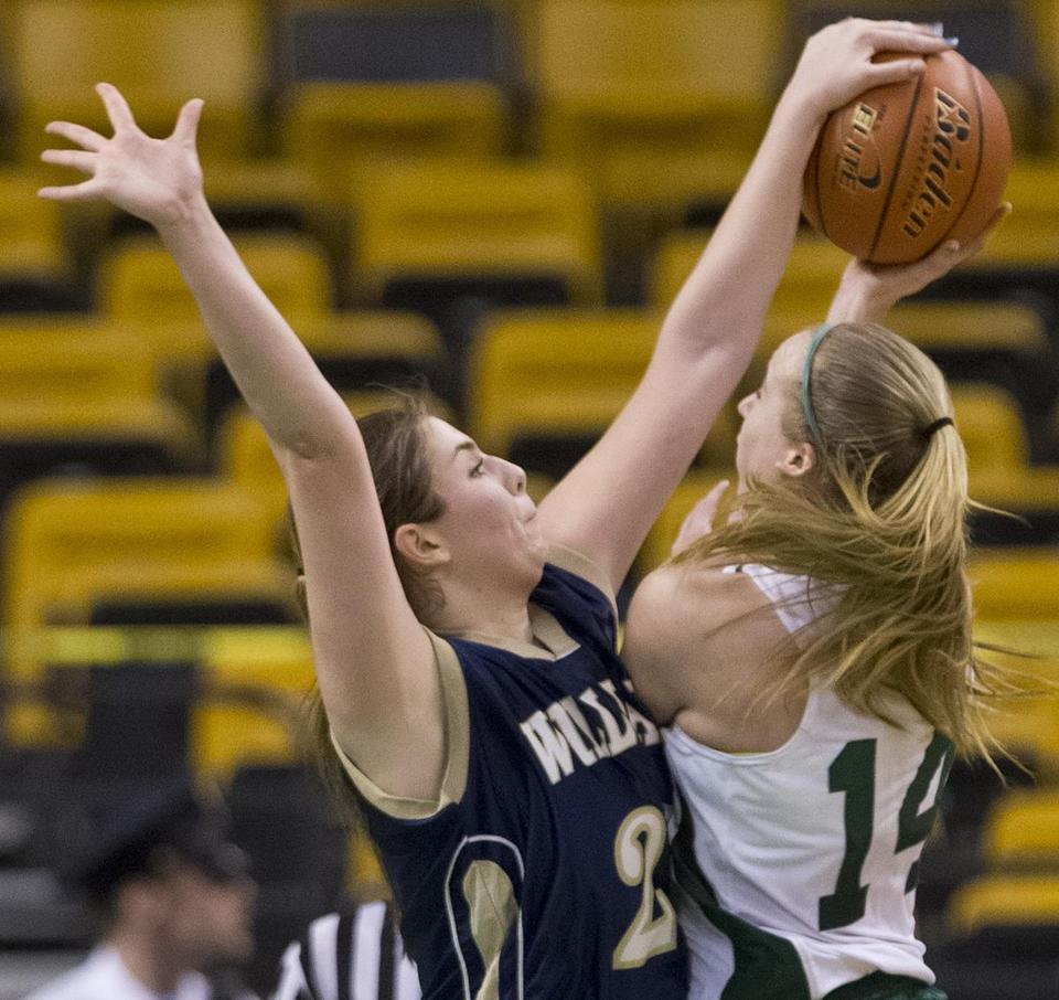 Olivia Conrad helped Archbishop Williams dominate play inside, here blocking a shot by Pentucket's Nicole Viselli.