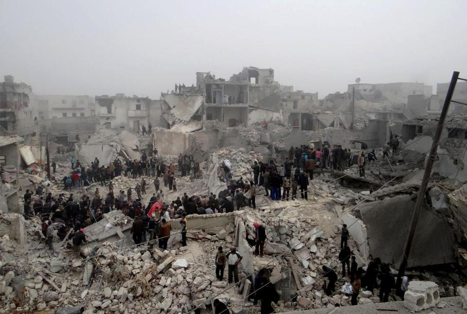 Syrians inspected the destruction on Feb. 19 following an apparent surface-to-surface missile strike in Aleppo.