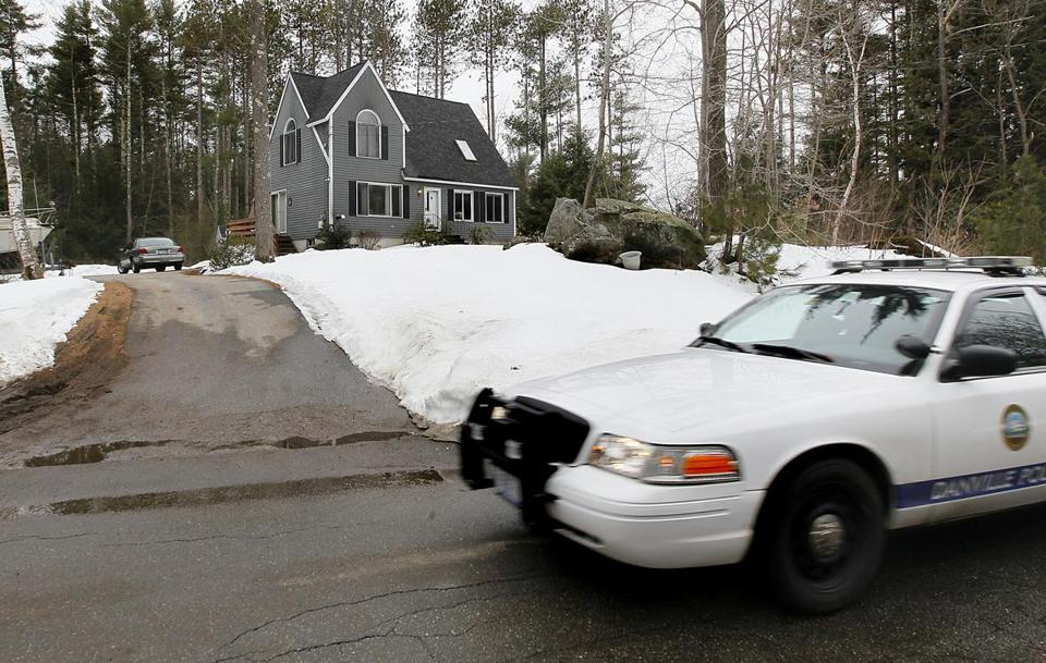 A cruiser was seen Tuesday outside the house of Police Chief Wade Parsons in Danville, N.H., after Monday's shooting.