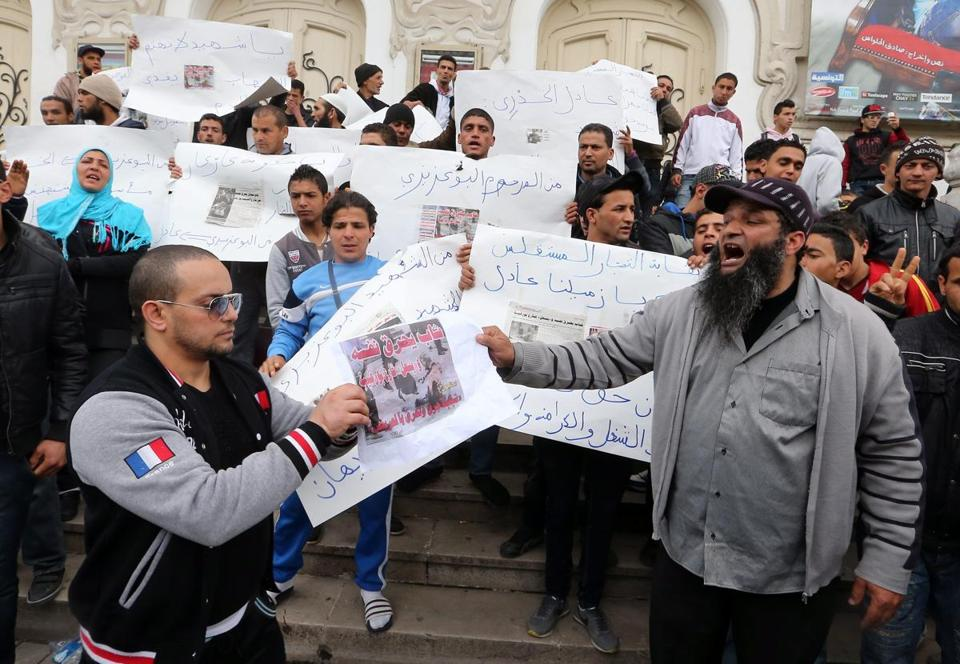 Tunisians shouted antigovernment slogans after a street vendor set himself on fire.
