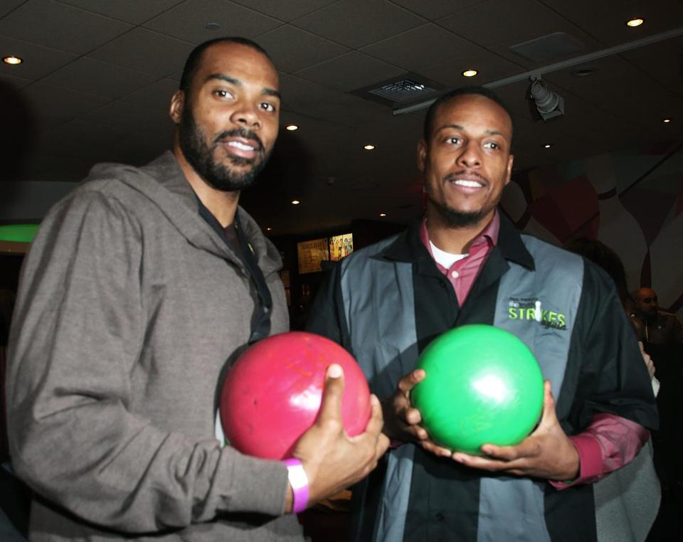 Chris Wilcox (left) and Paul Pierce get ready to bowl at Kings Dedham last night.