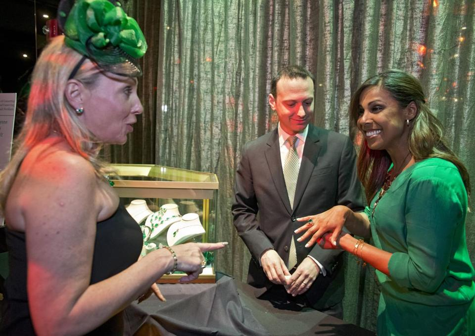Taniya Nayak (right) tries on an expensive ring with party planner Lynn Dale and Craig Rottenberg of Long's Jewelers last night.