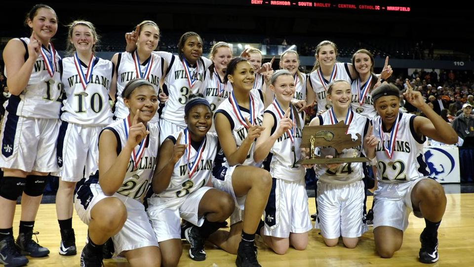 Archbishop Williams players celebrate the 60-33 win over Lee that brought them the state title in Worcester March 16.