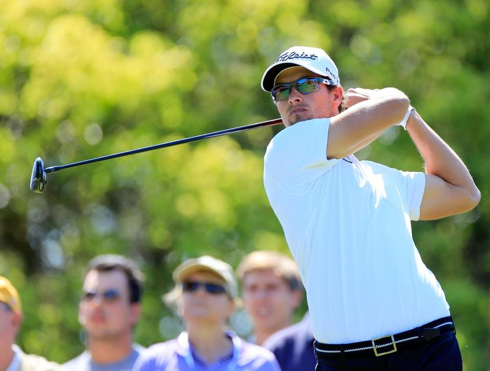 Adam Scott had birdie putts on 16 holes and trails by one shot after a 5-under-par 66 in the second round.