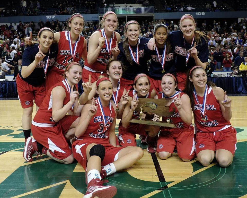 After beating Holy Name for the Division 1 state basketball title, the Central Catholic girls show off the spoils at the DCU Center.