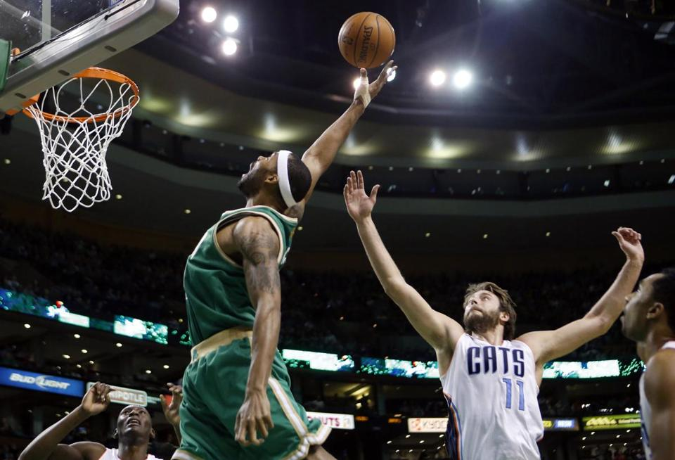 Boston Celtics' Chris Wilcox reached for a rebound in front of Charlotte Bobcats' Josh McRoberts in the first quarter.
