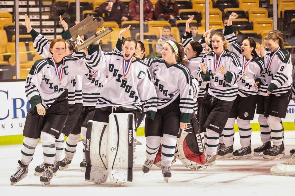 Duxbury celebrates their win after a game between Duxbury High School and Falmouth High School at the MIAA High School Hockey Championships held at the TD Garden in Boston.