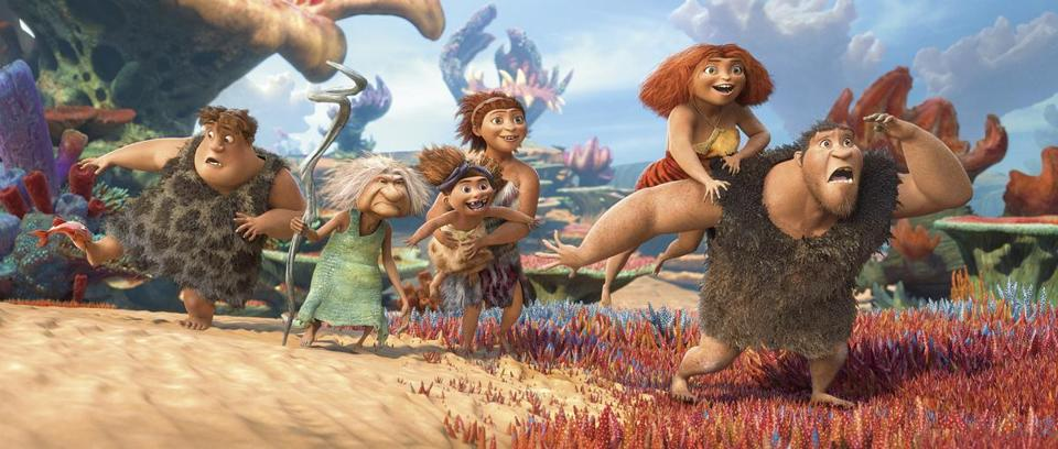 "From left: Thunk (Clark Duke), Gran (Cloris Leachman), Sandy (baby), Ugga (Catherine Keener), Eep (Emma Stone), and Grug (Nicolas Cage) in ""The Croods."""