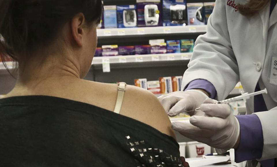 Walgreen runs the largest US drugstore chain. Above, a customer gets a flu shot.