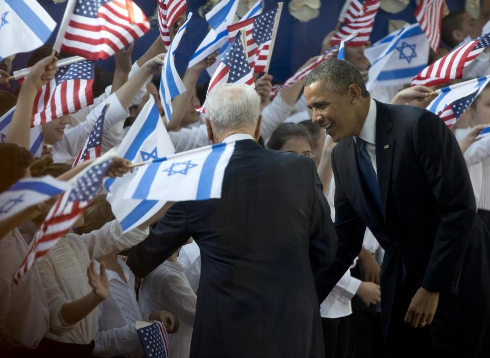 President Obama and Israeli President Shimon Peres greeted children on their arrival at Peres's residence Wednesday.