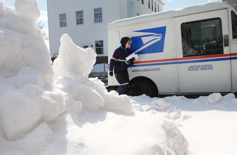The first day of spring didn't give mail carrier Pam Himmer much relief from the snow as she worked in Worcester.