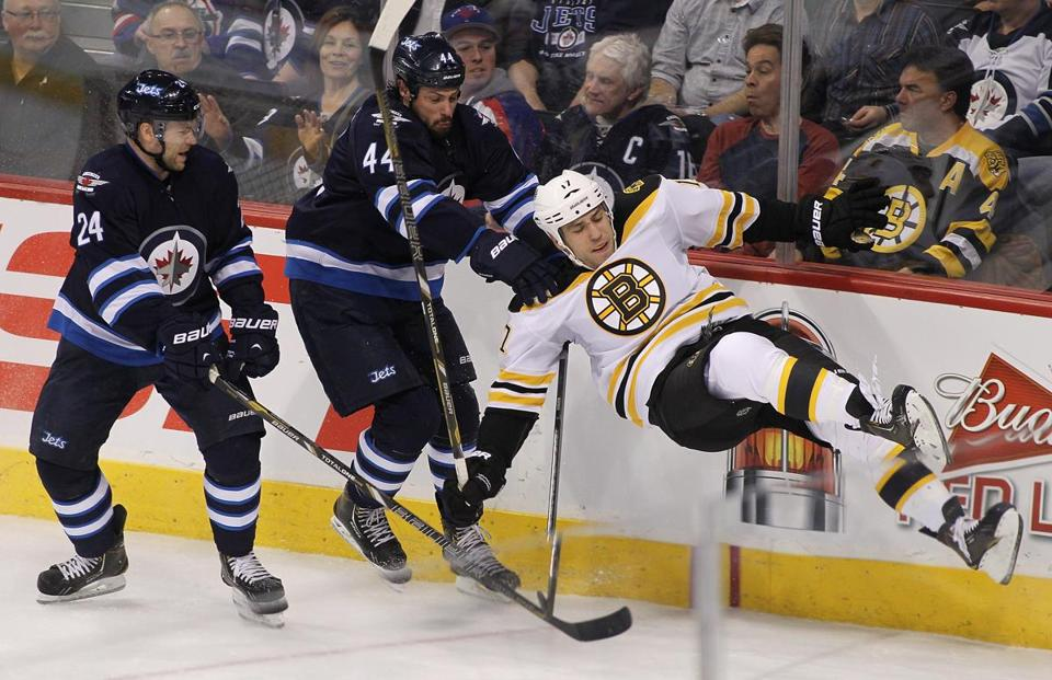 Winnipeg's Zach Bogosian sent Bruins' forward Milan Lucic flying after this first-period collision.