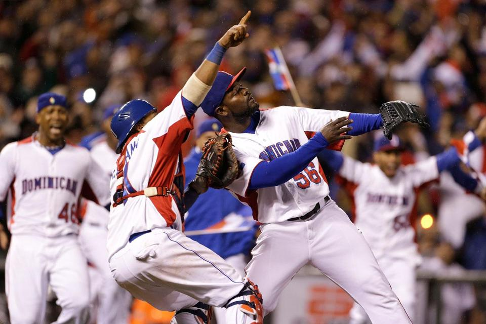 The Dominican Republic's Carlos Santana (left) and Fernando Rodney celebrated after beating Puerto Rico in the championship game of the World Baseball Classic.