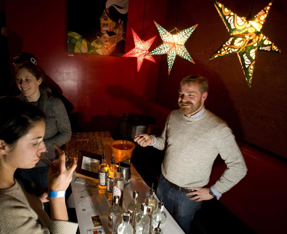 "Lonnie Newburn of South Boston's GrandTen Distilling was among the locals who supplied sips at ""Distill My Heart"" at Bella Luna in Jamaica Plain on Wednesday night."