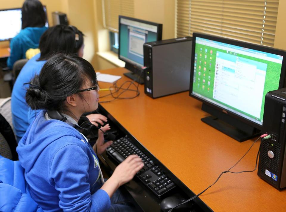 Kaiyun Lai accessed the Chinese social media website QQ at the Boston Chinatown Neighborhood Center.