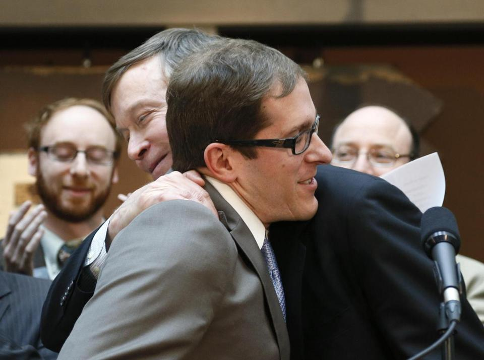 House Speaker Mark Ferrandino embraced Governor John Hickenlooper (right) after the bill was signed.