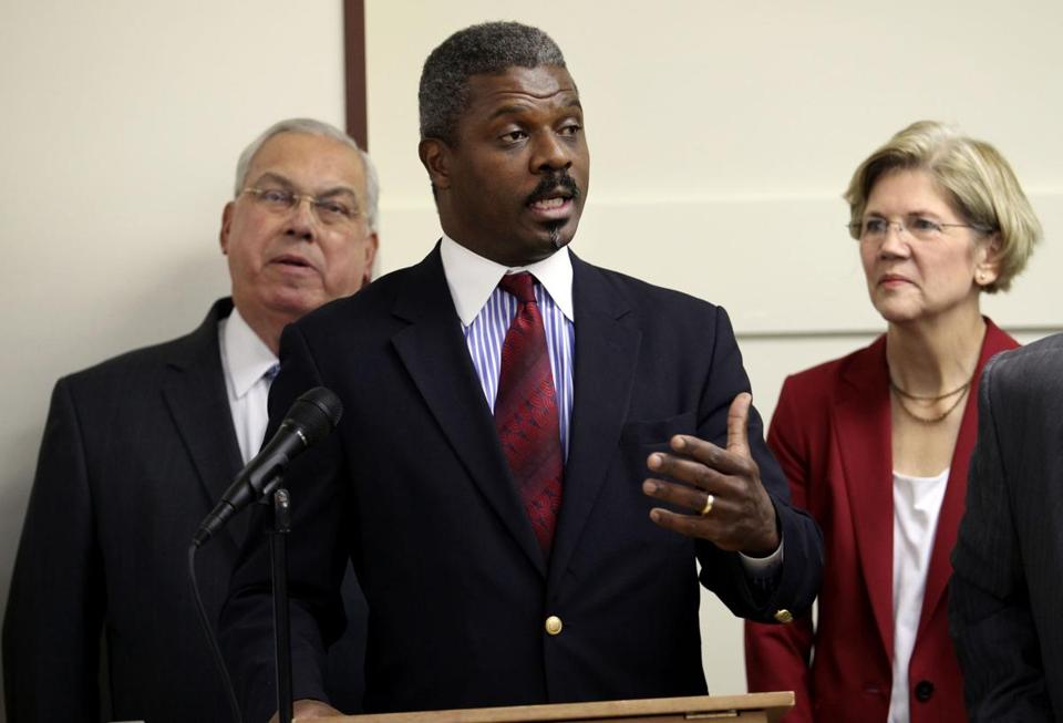 The Rev. Jeffrey Brown (center) is stepping down as TenPoint Coalition executive director.