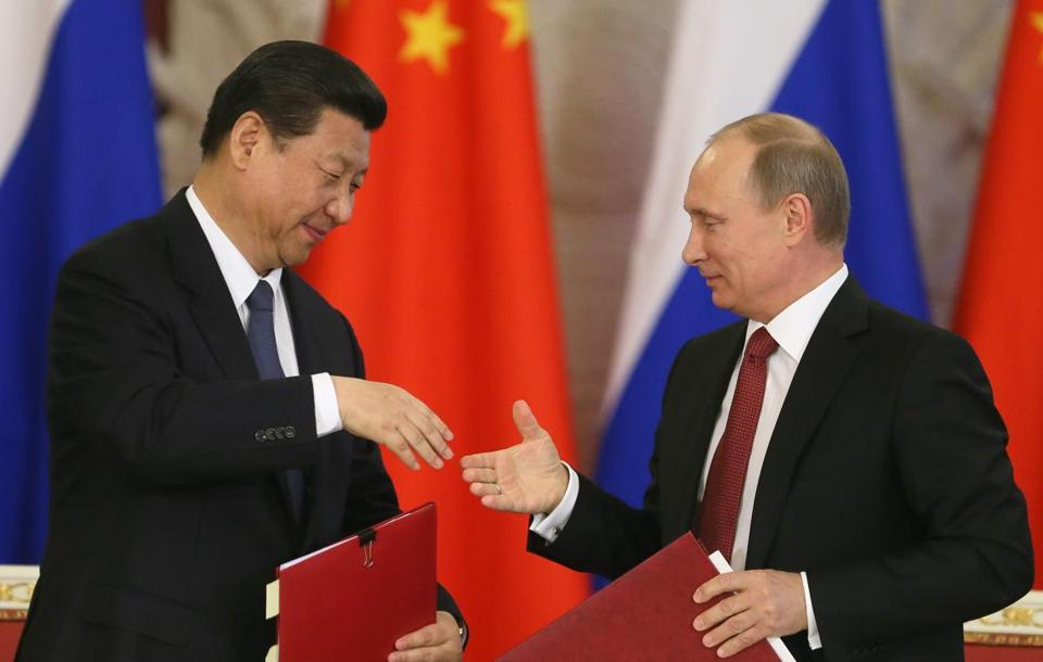 President Xi Jinping (left) of China and President Vladimir Putin of Russia signed documents in Moscow for a gas delivery pact by Russia's Gazprom to energy-hungry China.