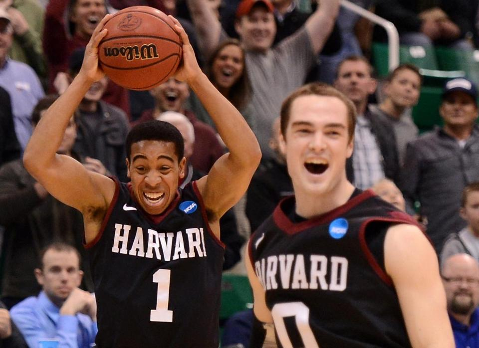 Siyani Chambers (left) and Laurent Rivard celebrate Harvard's first NCAA Tournament victory, a 68-62 decision over third-seeded NewMexico.