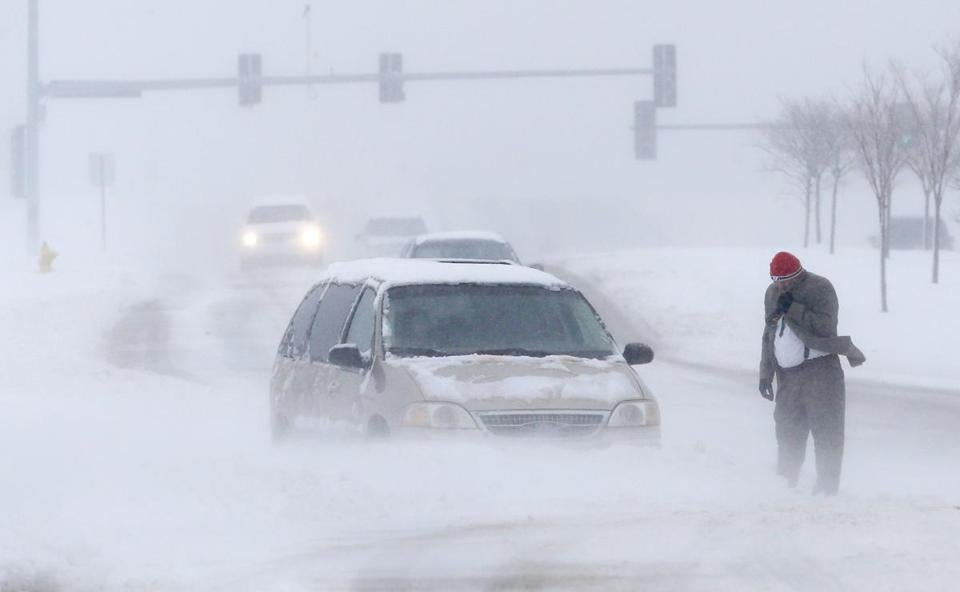 A man waited for help after becoming stuck in Lawrence, Kan., on Sunday as a weekend storm battered the region.