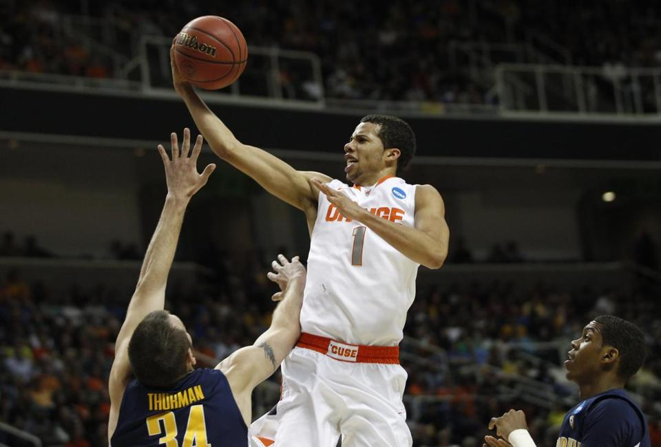 Syracuse's Michael Carter-Williams took a shot over California's Robert Thurman on Saturday.
