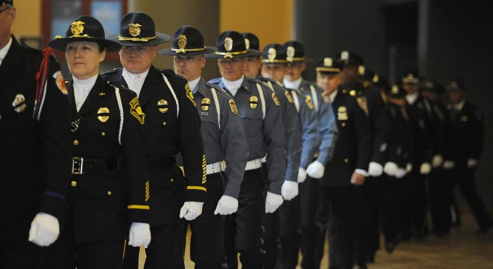 Police and corrections officers attended a memorial Monday for Tom Clements, Colorado's chief of corrections.