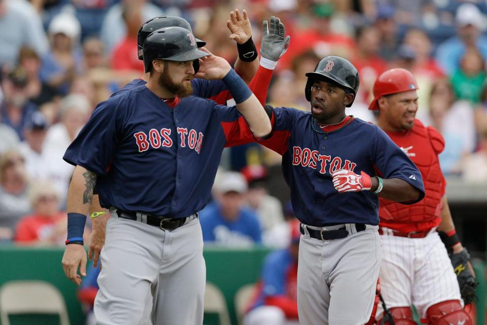 Will Middlebrooks and Jonny Gomes greeted Jackie Bradley Jr. after he hit a second-inning, three-run home run off of Phillies starting pitcher Cliff Lee.