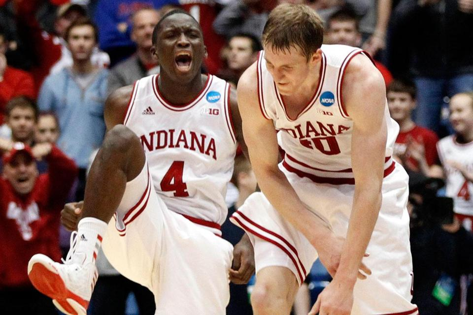 Victor Oladipo's late basket gave Indiana a leg up over Temple and gave Cody Zeller (right) something to celebrate.