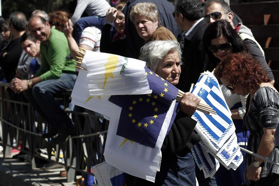 A woman sold flags in Nicosia on Monday before the Greek Independence Day parade.