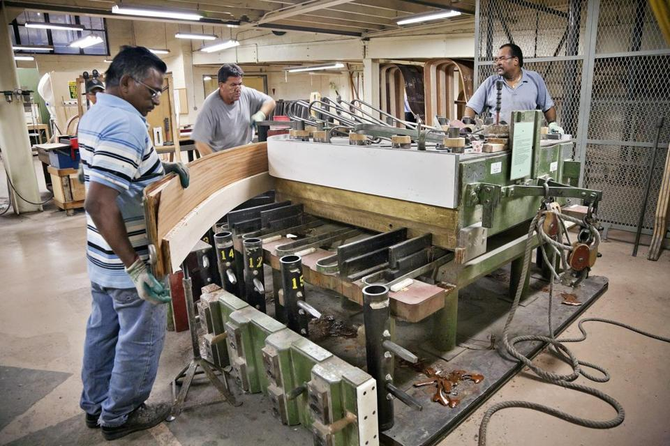 Craftsmen at Steinway's factory in Queens.