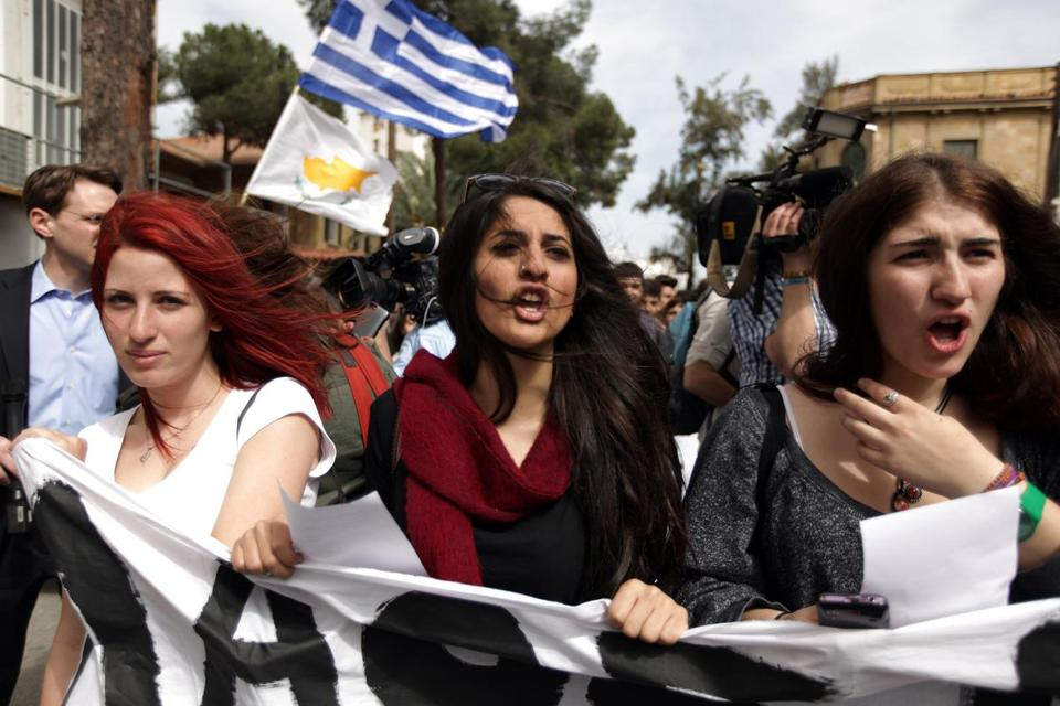 College students protested in Nicosia Tuesday against terms of the bailout for the financially crippled island of Cyprus.