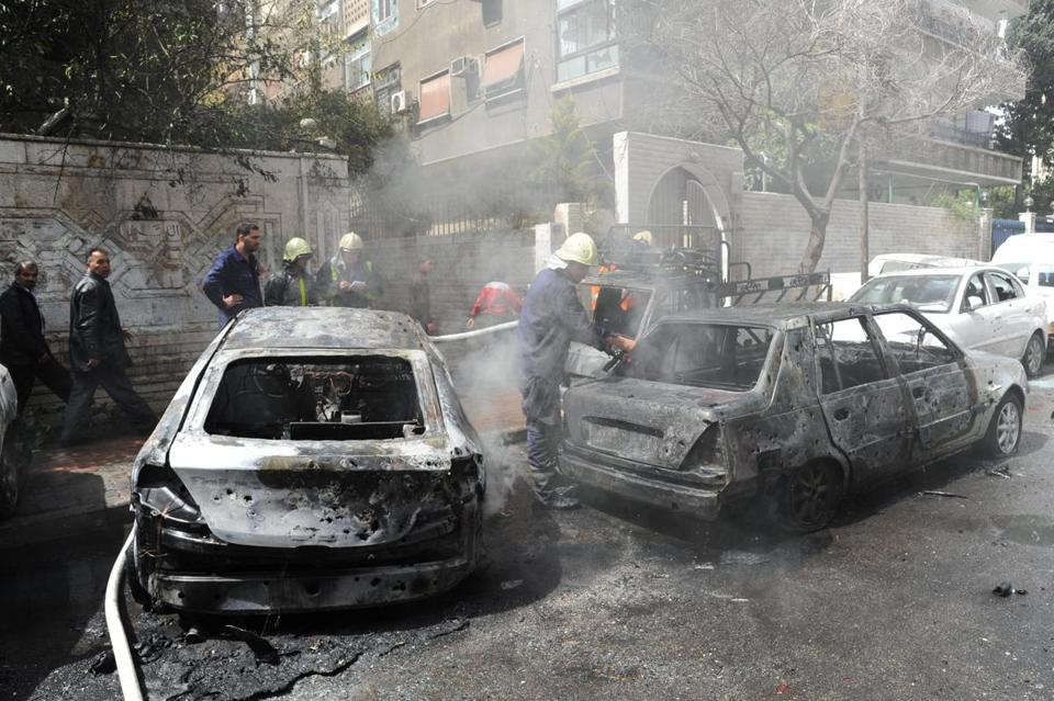 Several mortars caused damage and reportedly killed three people and wounded dozens in Damascus Tuesday. It was not known who fired the shells.