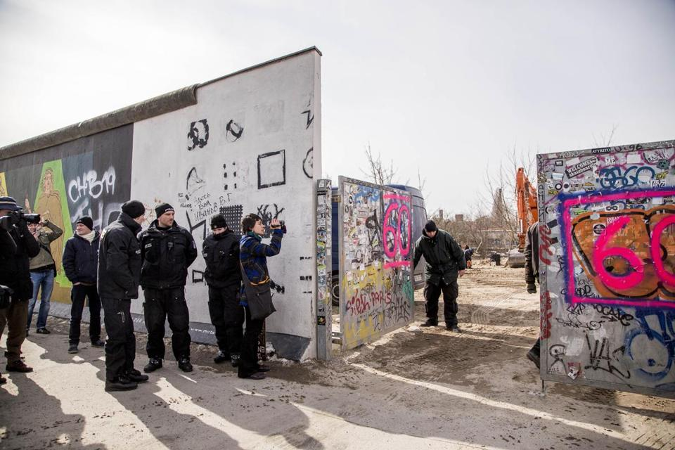 Several hundred police stood guard as about 15 feet of the Berlin Wall was removed.