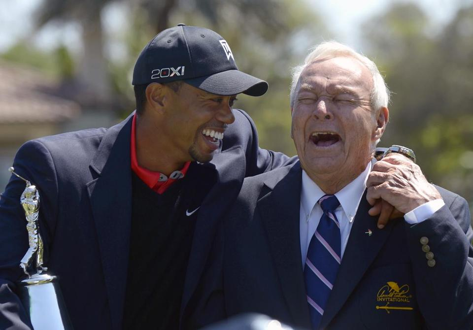 Tiger Woods, left, with Arnold Palmer after winning on Monday.