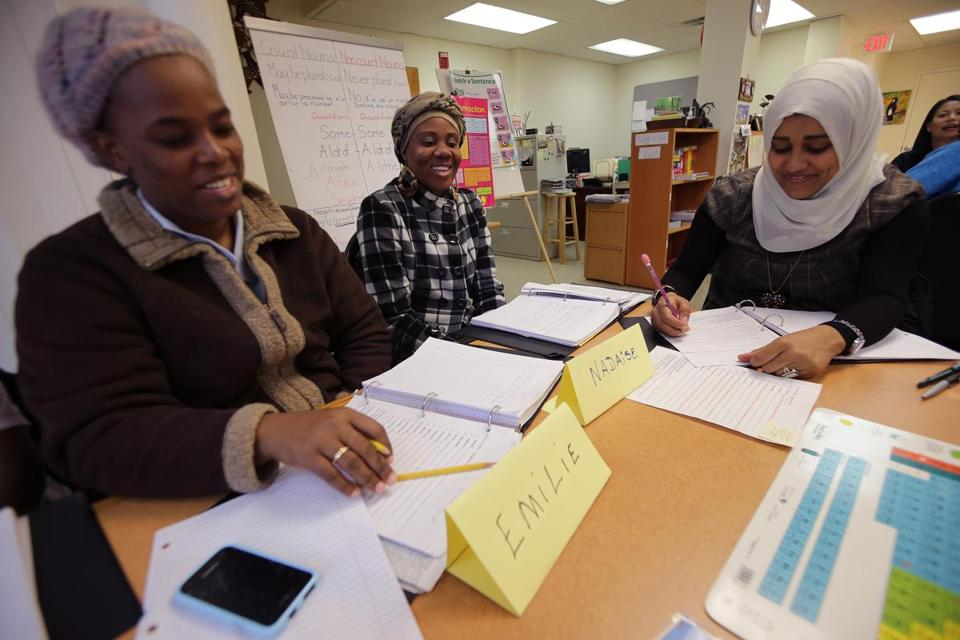Emilie Jean Baptiste, Nadaise Pierre Chery, and Ismahane Darsi, in an ESL class at the Immigrant Learning Center in Malden.