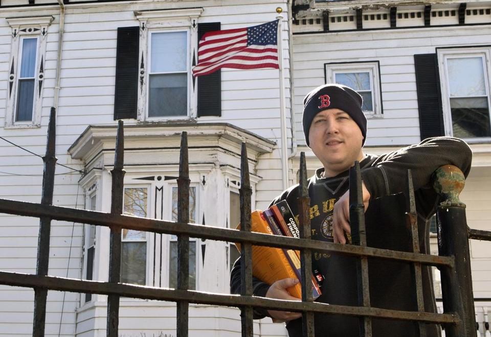 Stephen Wood outside his residence at the PLUS group home in Lynn.