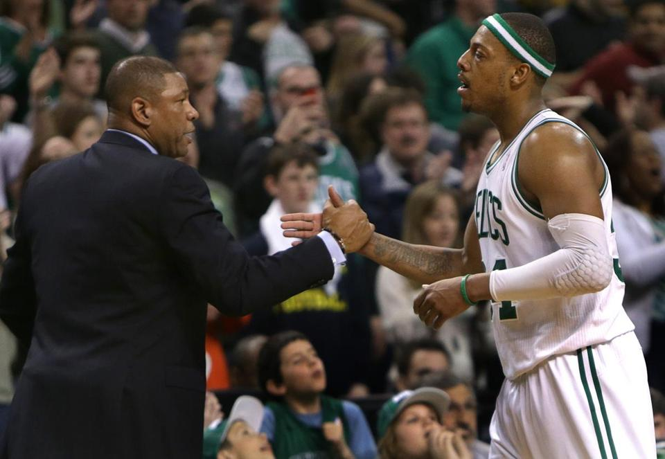 Celtics coach Doc Rivers gave Paul Pierce a hand after his triple-double of 20 points, 10 rebounds, and 10 assists.