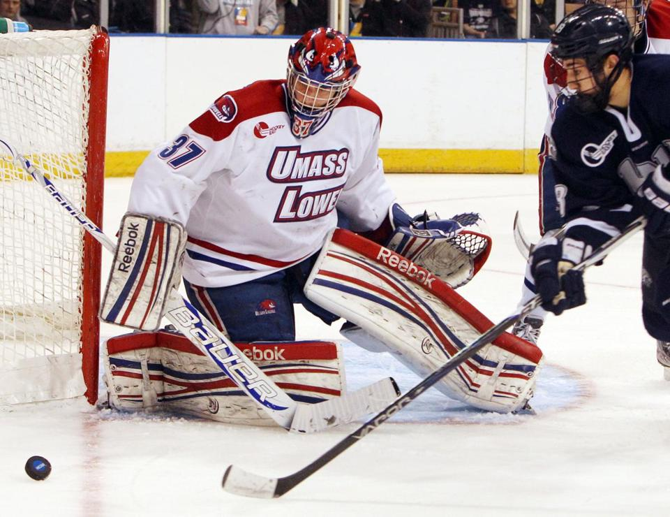 Coach Norm Bazin has goaltender Conor Hellebuyck and the UMass-Lowell team in the Frozen Four.