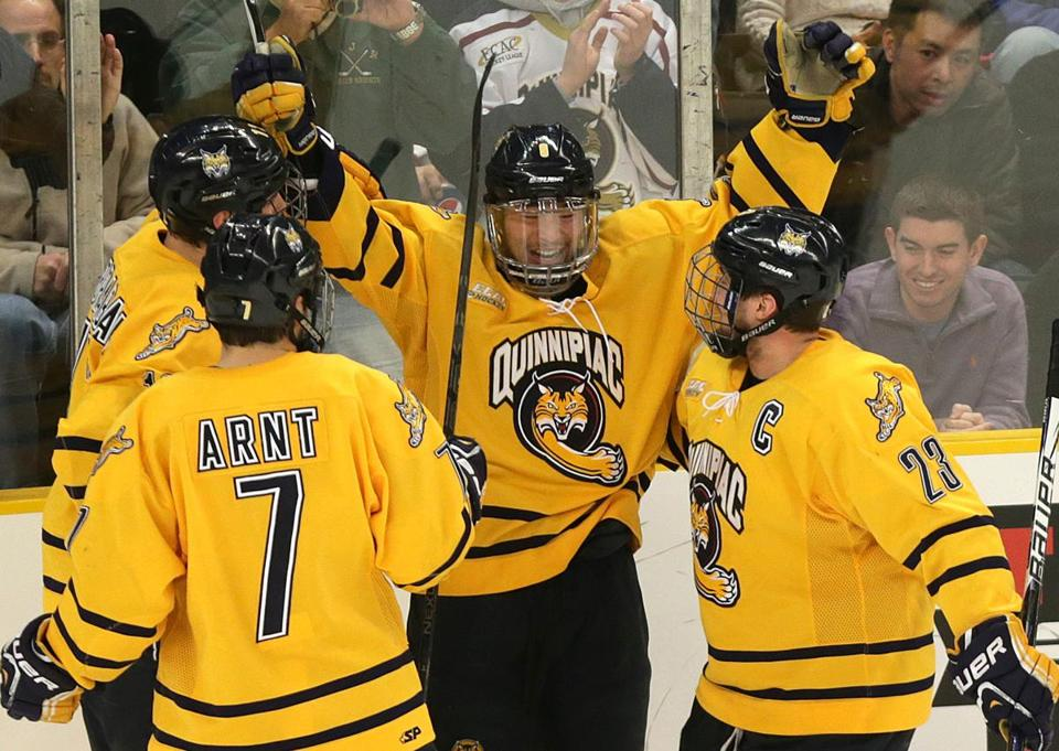 Quinnipiac's Kevin Bui (center) was ready for a celebration after he scored the winner.