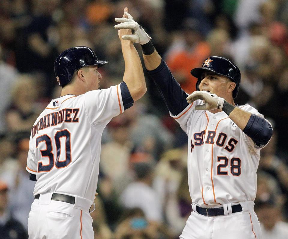 The Astros' Rick Ankiel (right) gets a hand from Matt Dominguez after hitting a three-run homer in the sixth inning.