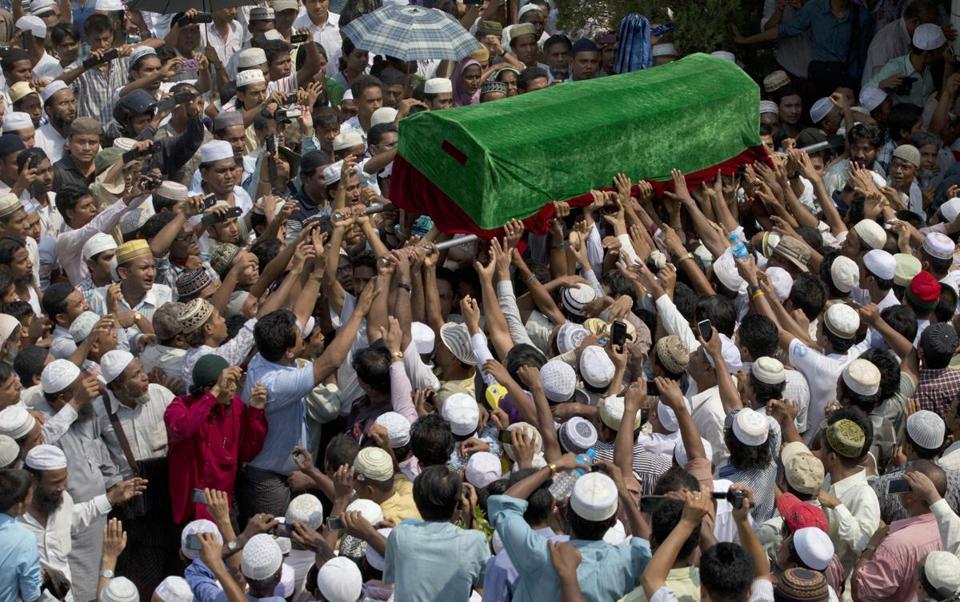 Muslim men carried a coffin containing the body of a victim of the fire on the outskirts of Yangon, Myanmar.