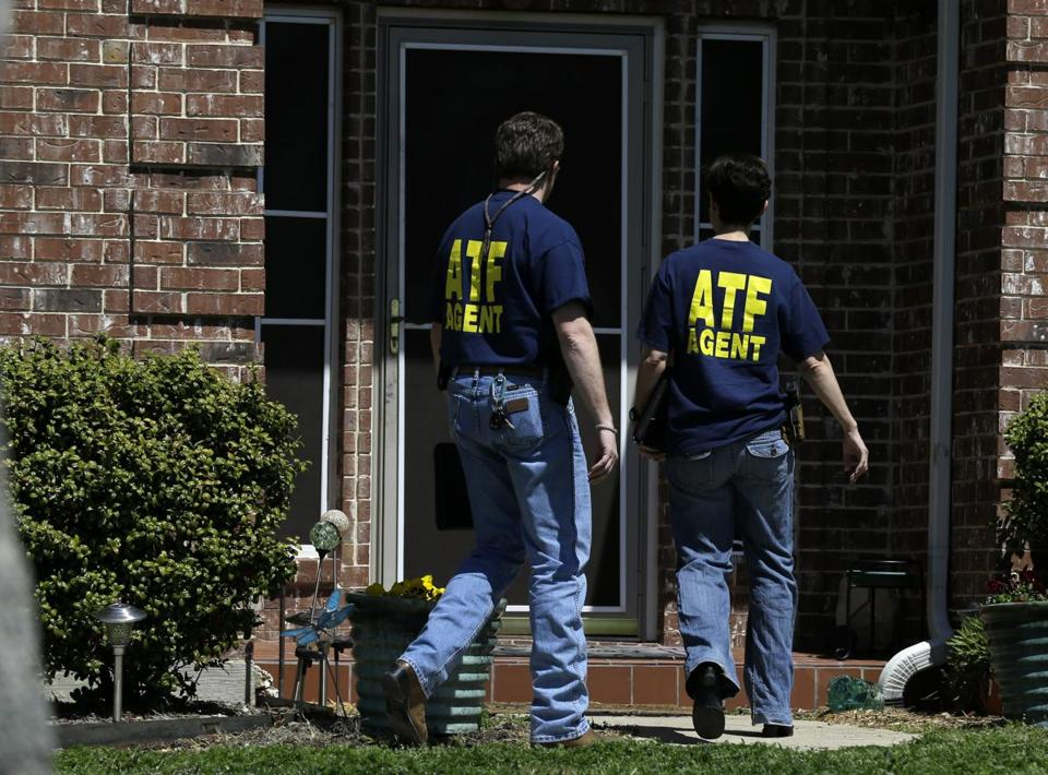 Bureau of Alcohol, Tobacco, Firearms and Explosives agents entered the home Monday of Kaufman District Attorney Mike McLelland, who was killed Saturday with his wife.