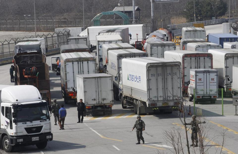 South Korean army soldiers gestured to turn back vehicles as they were refused to enter to Kaesong, North Korea.