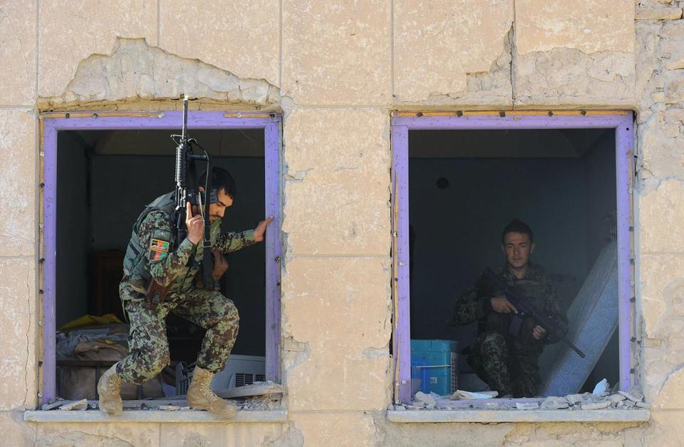 Afghan National Army soldiers were at a destroyed courthouse in Farah on Thursday after a Taliban suicide attack.