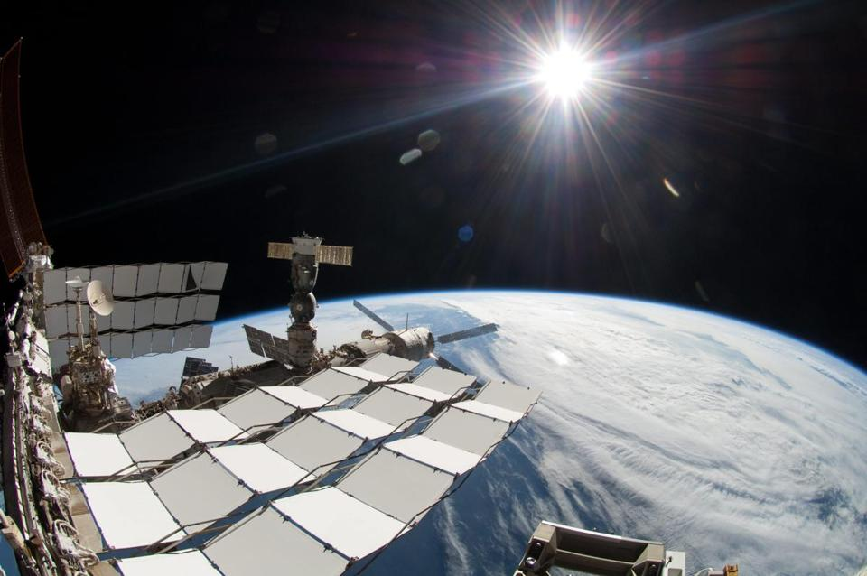 The Alpha Magnetic Spectrometer, which may have discovered preliminary evidence of dark matter, is carried aboard the international space station (above).