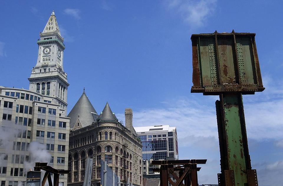 Among notable Boston buildings redeveloped by the the Beal Cos. are the Custom House (left) and Grain Exchange (center).