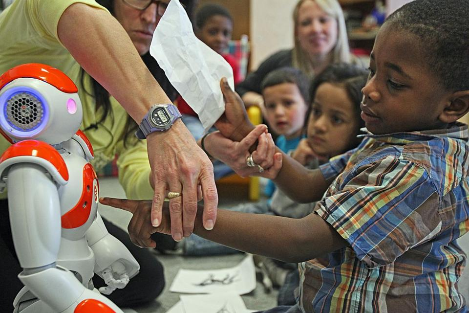 The Moody School in Haverhill is using robots to work with students, including Tobi Adebayo.