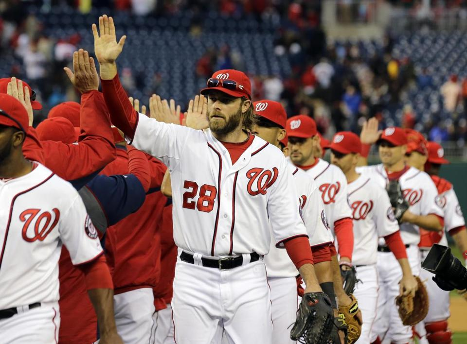 Jayson Werth high-fived his teammates after the Nationals swept their opening three-game series with the Marlins.