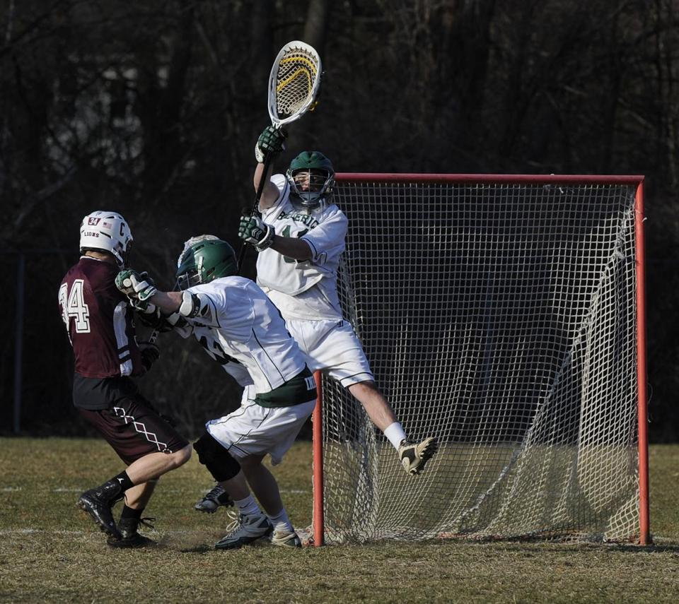Billerica senior D. J. Smith (right) covers the net as teammate Brian LeClair takes care of business in front of the net by blocking Chelmsford's Jon Fairbanks last week.