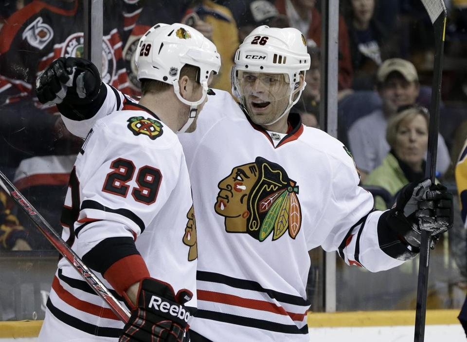 The Blackhawks' Bryan Bickell (left) is congratulated by Michal Handzus after scoring in the first period.